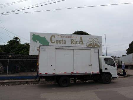 bienvenido: COSTA RICA - JULY 14: Bienvenido a Costa Rica - Sign behind a shipping truck near the border of Panama on July 14 2009 in Costa Rica.