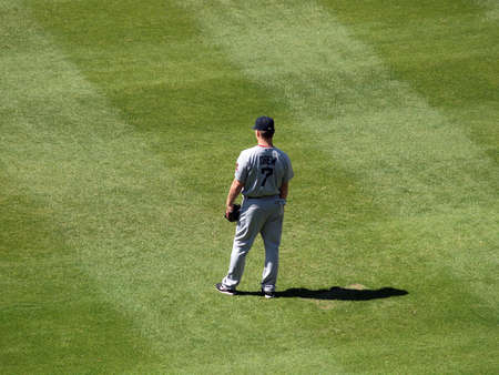outfield: OAKLAND, CA - SEPTEMBER 12: Red Sox vs. As: Red Sox Outfielder JD Drew stands in the outfield September 12, 2010 Coliseum Oakland California  Editorial