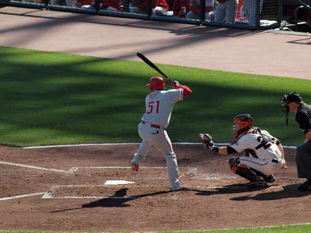 ruiz: SAN FRANCISCO, CA - OCTOBER 19: Phillies Carlos Ruiz steps forward to hit pitch with Catcher Buster Posey squatting ready to catch game 3 NLCS 2010 October 19, 2010 AT&T Park San Francisco.