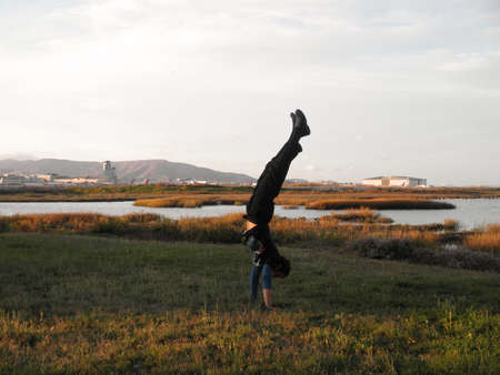 Handstanding Marshes outside of SFO Airport in San Francisco, California. photo