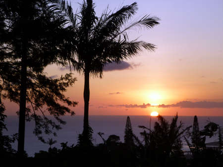 Sunset off the coast of Oahu, Hawaii seen high up in the mountains. photo