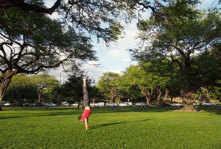 Handstanding Kapiolani Park in Honolulu, Hawaii. Stock Photo - 13446052