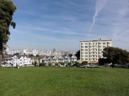 Painted Laides Victorian houses in San Francisco with downtown in the background in Famous Alamo Square in San Francisco, California photo