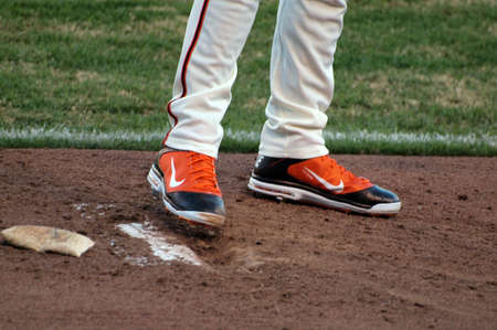 fined: SAN FRANCISCO, CA - JULY 28: Giants Closer Brian Wilson Wearing Orange Shoes with black trim a modification of the bright orange shoes he was fined for at ATT Park on July 28 2010 in San Francisco.