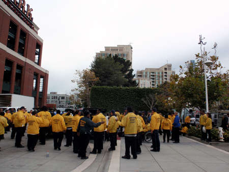 SAN FRANCISCO, CA - OCTOBER 27: Landmark Event Staff gather outside ballpark wearing yellow rain jackets as they prepare for event at ATT Park on October 27, 2010 in San Francisco. Stock Photo - 13887754