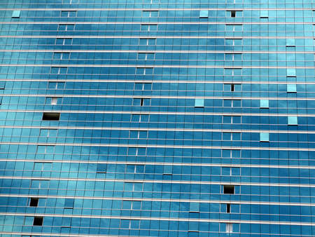 Blue Glass Windows reflect clouds and Sky with some windows open. Stock Photo - 14318020