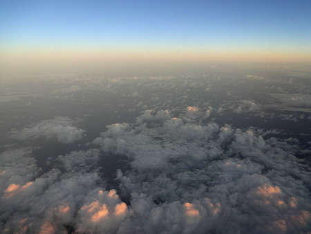 Light Cloud  scape at Dawn from high above taken from an airplane over the pacific ocean.                                photo