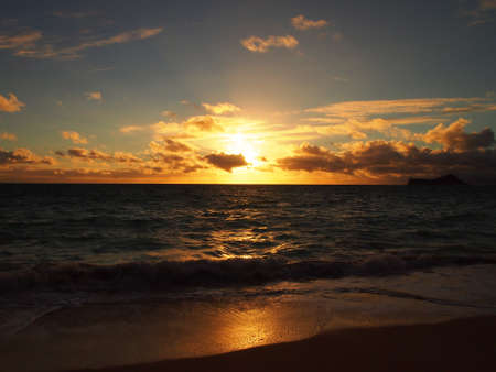 winter sunrise: Sunrise Waimanalo Beach on Oahu, Hawaii. With  rabbit island seen in the distance