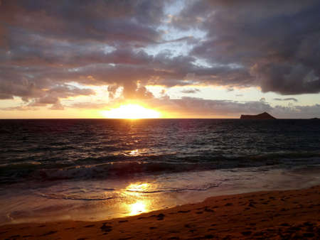 Early Morning Sunrise on Waimanalo Beach on Oahu, Hawaii with rabbit island seen in the distance  photo