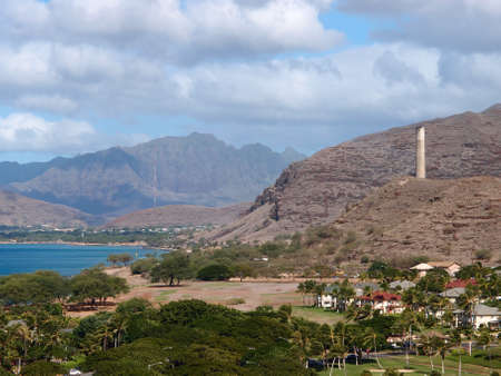 Ko Olina and the Waianae Coast with Mountains in the background, and historic smoke stack on the hilltop  Stock Photo