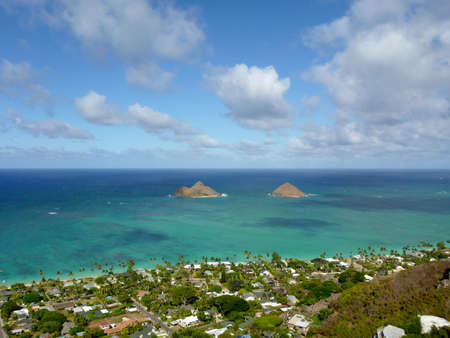 Mokulua  meaning, in Hawaiian,  the two islands   are two islets off the windward coast of Oahu in the Hawaiian Islands, and  the beach town of Lanikai  Banco de Imagens