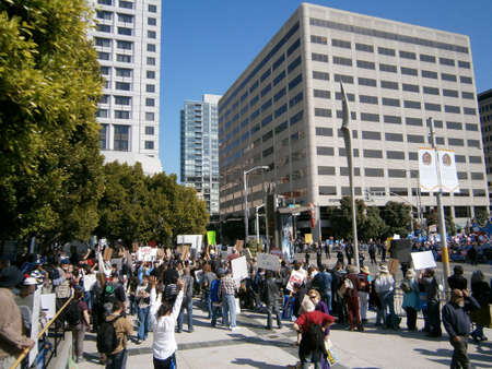 demonstrator: SAN FRANCISCO, CA - OCTOBER 25: Protesters hold Signs and rally behind SFPD fence along 3rd street as cops gaurd the street on October 25, 2011 in San Francisco. Editorial