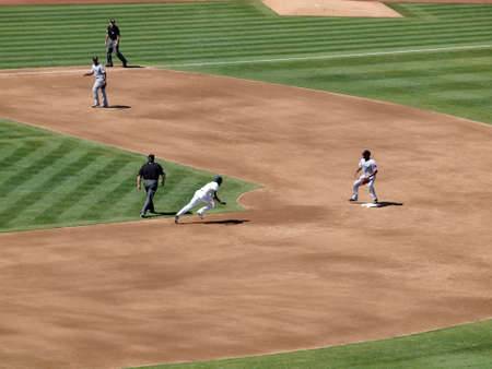 OAKLAND, CA - SEPTEMBER 12: Red Sox vs. A's: A's Coco Crisp runs towards second base as he attemps to steal the base. September 12 2010 Coliseum Oakland California Stock Photo - 17862666