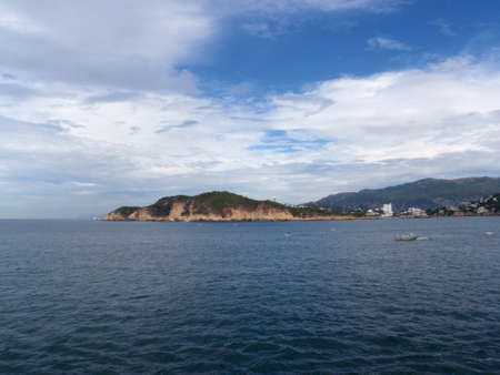 Acapulco Shoreline and Bay with boats in the water on a nice day  Stock Photo