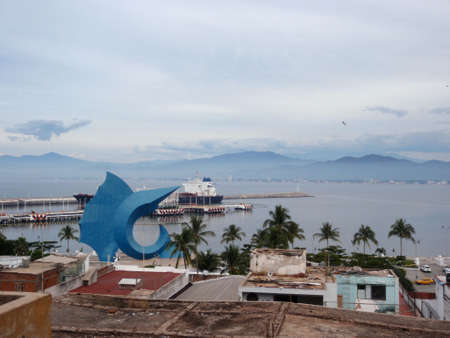 Manzanillo Harbor, Townscape, and Large blue Sail Fish Sculpture in Mexico with bird soaring in air  Stock Photo - 18153348