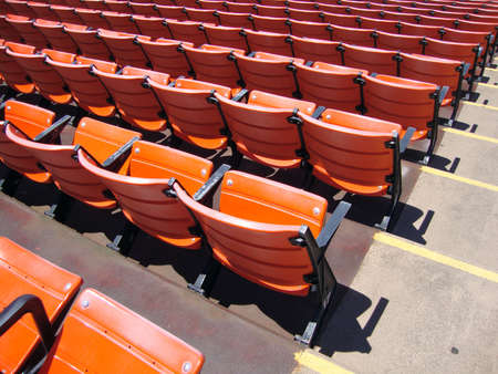 Rows of empty orange stadium seats  At Candlestick stadium in San Francisco  Stock Photo - 18153568