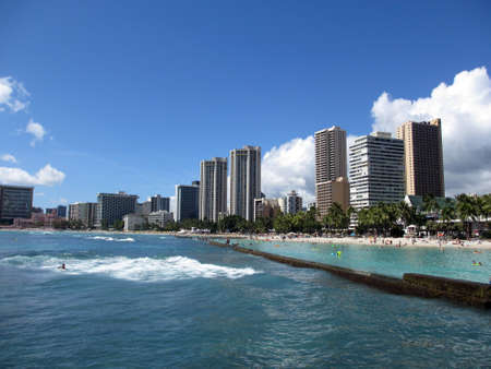 Ocean Water, Waikiki Beach, and Hotel Towers on a gorgous day on the island of Oahu, Hawaii Stock Photo - 18153597