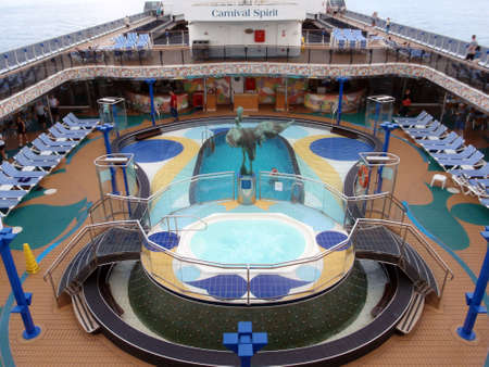 PACIFIC OCEAN - JANUARY 9: people enjoy Pool deck of Cruise ship the Carnival Spirit out at sea on the Pacific Ocean on January 9 2010. Stock Photo - 18306248