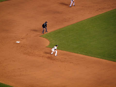 SAN FRANCISCO, CA - OCTOBER 28:Giants Runner Andres Torres takes large lead from Second Base during game 2 of the 2010 World Series game between Giants and Rangers Oct. 28, 2010 AT&T Park San Francisco, CA. Stock Photo - 18306251