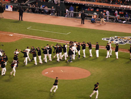 SAN FRANCISCO, CA - OCTOBER 28: Giants Players stand in line and high five to celebrate winning game 2 of the 2010 World Series game between Giants and Rangers Oct. 28, 2010 AT&T Park San Francisco, CA. Stock Photo - 18306252