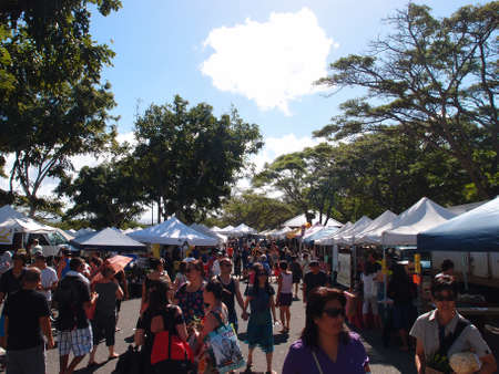 HONOLULU, HI - FEBRUARY 9: People explore booths at KCC Saturday Farmer Stock Photo - 18306249