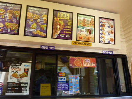HONOLULU - JULY 31: Taco Bell order counter and Menus featuring a variety of brand name products at the Kapalulu store on July 31 2012 in Honolulu, Hawaii. Stock Photo - 18306246