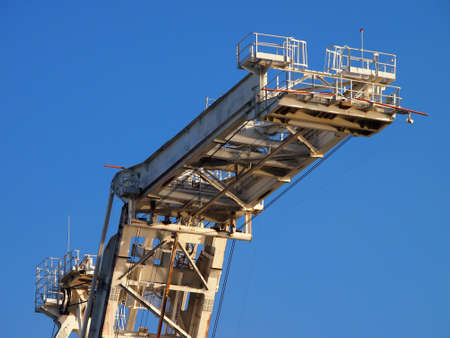Lifting arm of Large crane with blue sky in Oakland Harbor, California. photo