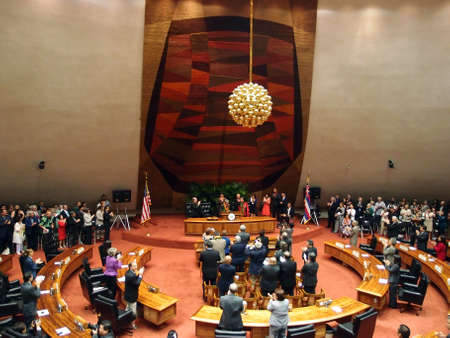 HONOLULU, HI - JANUARY 14: Former U.S. Senator Daniel Akaka gets standing ovation from audience which includes the Hawaii state Legislature and the Governor Neil Abercrombie of which surround him on stage. January 14, 2013 at the State Capitol in Honolulu