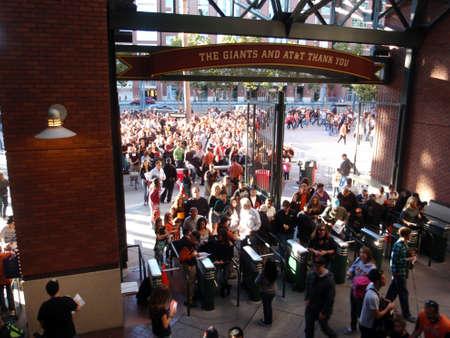 SAN FRANCISCO - SEPTEMBER 18: Large Crowd of People entering AT&T Park on September 18 2011 at Att Park in San Francisco California.