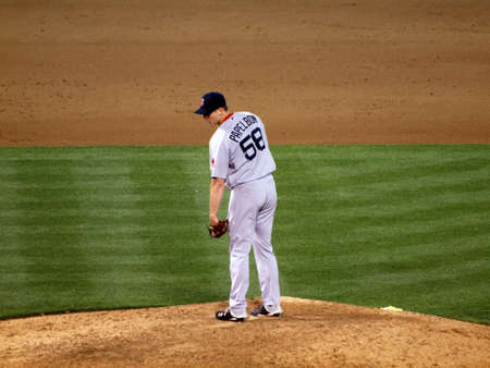 ca he: OAKLAND, CA - JULY 19: Red Sox vs. Athletics: Red Sox closer Jonathan Papelbon stands on mound looking towards home plate as he prepares to throw pitch. Taken on July 19, 2010 at the Coliseum in Oakland California.