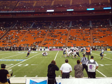 collide: HONOLULU, HI - NOVEMBER 24: UNLV vs. UH - Football players collide on the line of scrimmage near the goal line as Quarterback get tackled at Aloha Stadium November 24, 2012 on Oahu, Hawaii.