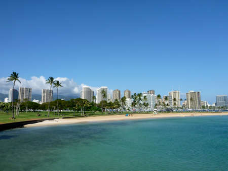 Beach on Magic Island in Ala Moana Beach Park on the island of Oahu, Hawaii.  On a beautiful day. photo