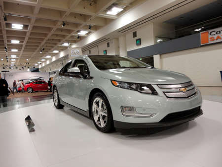 plugin: SAN FRANCISCO, CA - NOVEMBER 20: Plug-in Hybrid car the Chevy Volt on display on a spinning platform is displayed at the 53rd International Auto Show, on Saturday November 20, 2010 San Francisco CA.