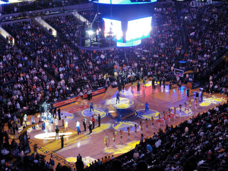 OAKLAND, CA - FEBRUARY 22: Light show goes on during Golden State Warriors intro to game as cheerleaders pump up crowd. Taken February 22, 2011 Oracle Arena Oakland, CA.