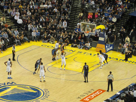 OAKLAND CA - MARCH 11: Magic vs. Warriors: Golden State Warriors Stephen Curry takes free throw shoot at Oracle Arena taken March 11 2011 Oakland California.