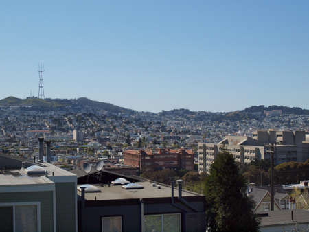 View of San Francisco Buildings, homes, towers, and hills on a clear day. photo