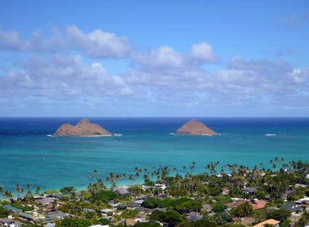 The Mokulua Islands, Lanikai Beach, and nice homes as seen from above in Kailua, Oahu, Hawaii