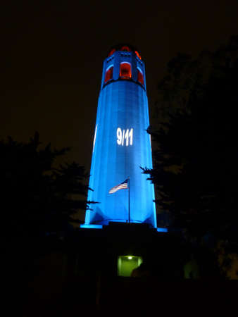 artdeco: SAN FRANCISCO - SEPTEMBER 11: 911 Memorial projected of red, white and blue colors on Historic Coit Tower on September 11 2013 in San Francisco, California.