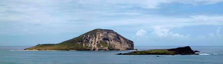 windward: Manana Island and Kaohikaipu Island are located on the Windward side of Oahu, north of Makapuu Point. The shape of the island actually resembles a rabbit the island both isalnds are seabird sanctuary. Three species of bird nest on the island Stock Photo