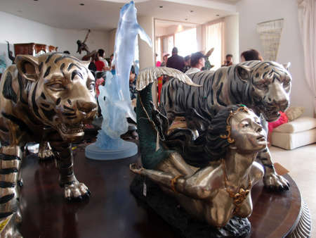 HONOLULU, HI - NOVEMBER 23: Tigers, Dolphins, and a Mermaid Sculputres display on a table at auction at the infamous Genshiro Kawamoto auction in Kahala, Top-selling single item selling was for $7500 at the event on November 23, 2013 in Honolulu, Hawaii.