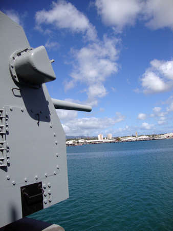 Large Metal Guns on the Historic USS Missouri looking out into Pearl Harbor on Oahu, Hawaii.