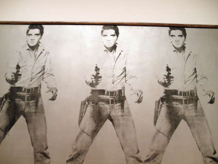 andy: SAN FRANCISCO - AUGUST 12: World Famous Artist Andy Warhol (American, 1928-1987) Triple Elvis art piece featuring a photo of Elvis Presley holding a Gun, 1963. Acrylic and silkscreen ink on canvas. 82 x 118 in. (208.3 x 299.7 cm). Doris and Donald Fisher