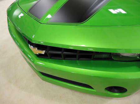 SAN FRANCISCO, CA - NOVEMBER 20: Bright Green Chevy Camero Car Hood is displayed at the 53rd International Auto Show, on Saturday November 20, 2010 San Francisco CA. Редакционное