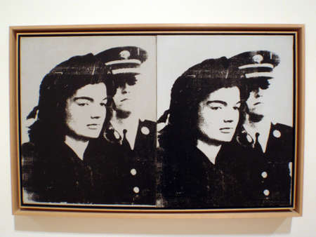 andy warhol: SAN FRANCISCO - JANUARY 25:  Iconic image of Sad Jackie Kennedy standing next to officer Screenprint on Canvas by world famous artist Andy Warhol silkscreen ink on canvas. Taken January 25, 2010 at the San Francisco Museum of Modern Art in California.  Editorial