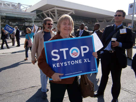 keystone light: SAN FRANCISCO, CA - OCTOBER 25: Female Protester hold large Signs saying STOP KEYSTONE XL on Howard street during protest of Presidents fundraiser visit to the city on October 25, 2011 in San Francisco.
