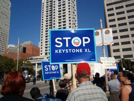 keystone light: SAN FRANCISCO, CA - OCTOBER 25: Protesters hold large Signs saying STOP KEYSTONE XL and the Enviroment Mr. President remember on Howard street during protest during protest of Presidents fundraiser visit to the city on October 25, 2011 in San Francisc