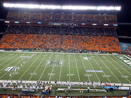 kickoff: HONOLULU - SEPTEMBER 22: UH Hawaii Warriors sets up to kickoff the ball to Nevada Wolf Pack at night with whole view of field at Aloha Stadium in Honolulu, Hawaii on September 22, 2012.  Editorial
