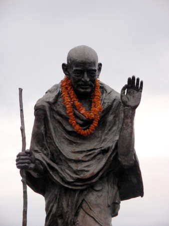 mahatma: Statue of Ghandi wearing an orange lei in the Embarcadero center, San Francisco, California Editorial