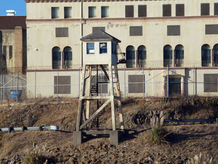 Tall Lookout Tower at San Quentin State Prison California with Prison behind it surrounded with Barbwire fence