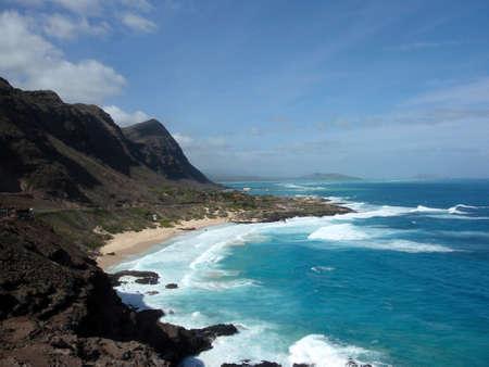 windward: Waves crash on Makapuu Beach with the Koolau Range Mountains above looking towards Waimanalo Bay on the Windward coast of Oahu, Hawaii. Stock Photo